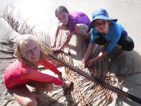 Weaving on the beach