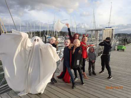 Guess who's under the sheet- trick or treating with the kid boat crew!